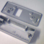 What are the components of a die-casting mold?